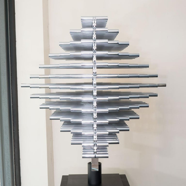 Monumental articulated stainless steel rod modern sculpture on a black metal base by Giuseppe Minoretti.