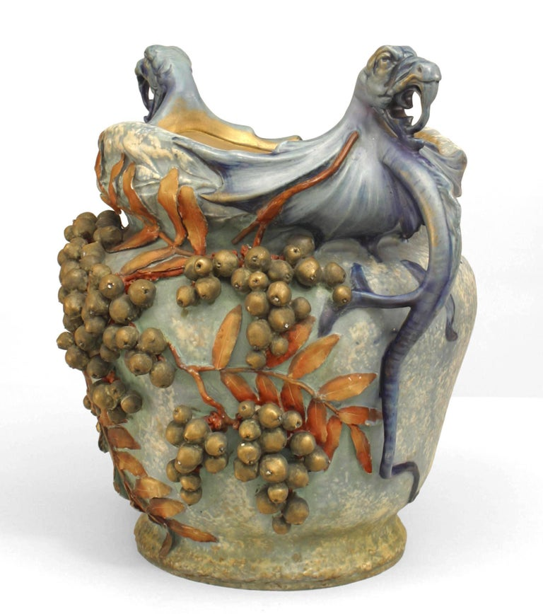 Early 20th century Austrian monumental blue/green Amphora jardiniere with twin cobra handles, decorated with grapes and leave. The work is signed