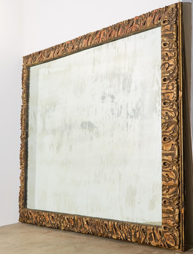 Hand-Crafted Monumental Baroque Style Parcel Gilt Carved Mirror For Sale