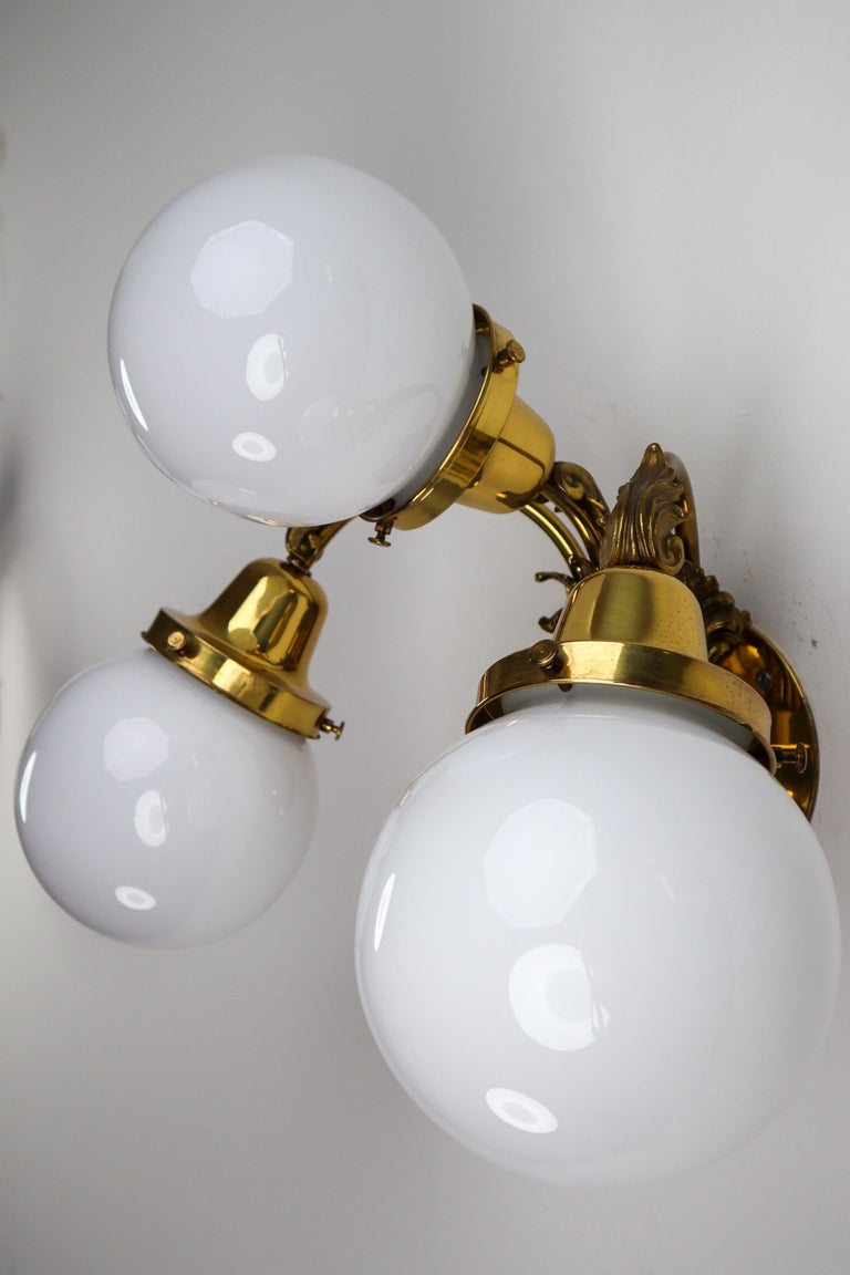 Monumental Brass Chandelier and Four Wall Lights with Opaline Glass Globes For Sale 5