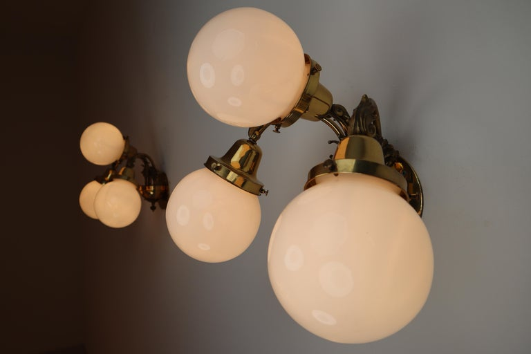 Monumental Brass Chandelier and Four Wall Lights with Opaline Glass Globes For Sale 10