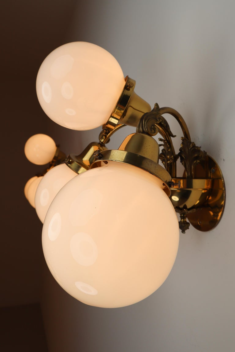 Monumental Brass Chandelier and Four Wall Lights with Opaline Glass Globes For Sale 12