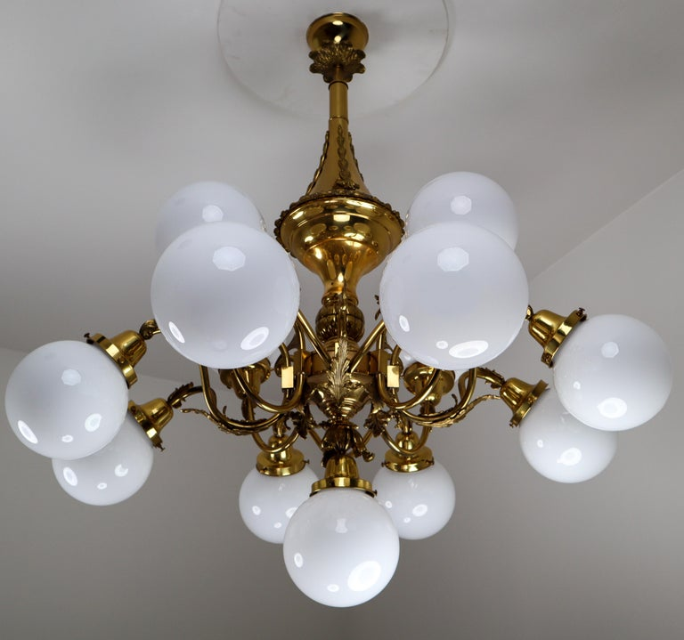 Monumental brass chandelier and four wall lights with opaline glass globes from the National Gallery Praque.  Monumental and chic design chandelier and four wall lights with high quality brass fixture and luxury opaline glass globes. This