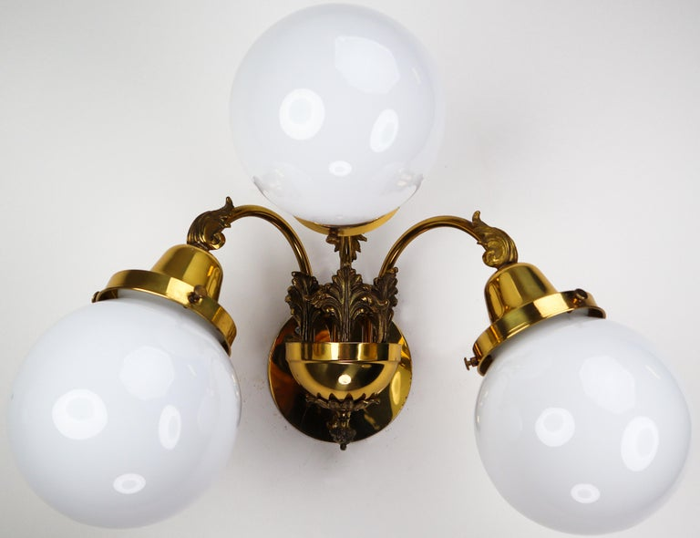 Baroque Monumental Brass Chandelier and Four Wall Lights with Opaline Glass Globes For Sale