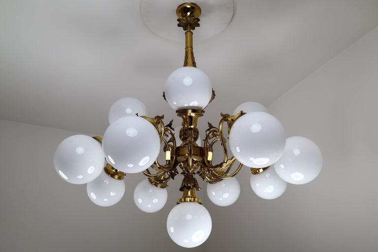 Czech Monumental Brass Chandelier and Four Wall Lights with Opaline Glass Globes For Sale