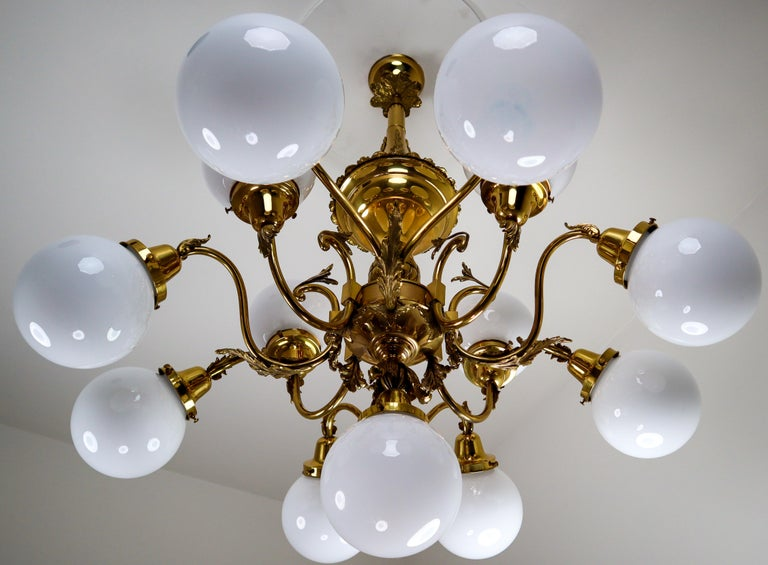Monumental Brass Chandelier and Four Wall Lights with Opaline Glass Globes For Sale 1