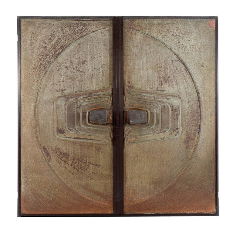 Architectural doors, exterior side, Brutalist bronze patina with large solid brass pulls, opposite interior side, hammered copper with solid Bronze lever pulls, quality locks and cylinders, need to be re-keyed, peep hole with removable