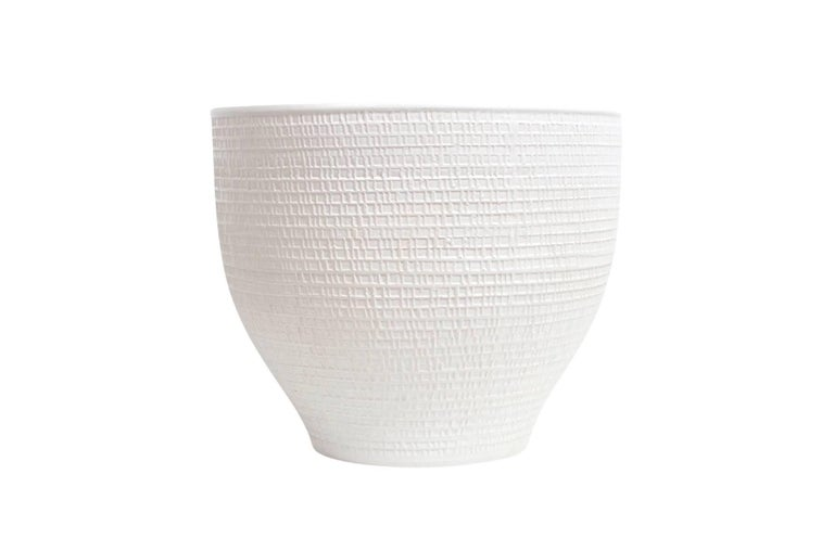 Monumental ceramic vessel / planter by David Cressey for Architectural Pottery. Subtle textured exterior surface with bone white glaze.