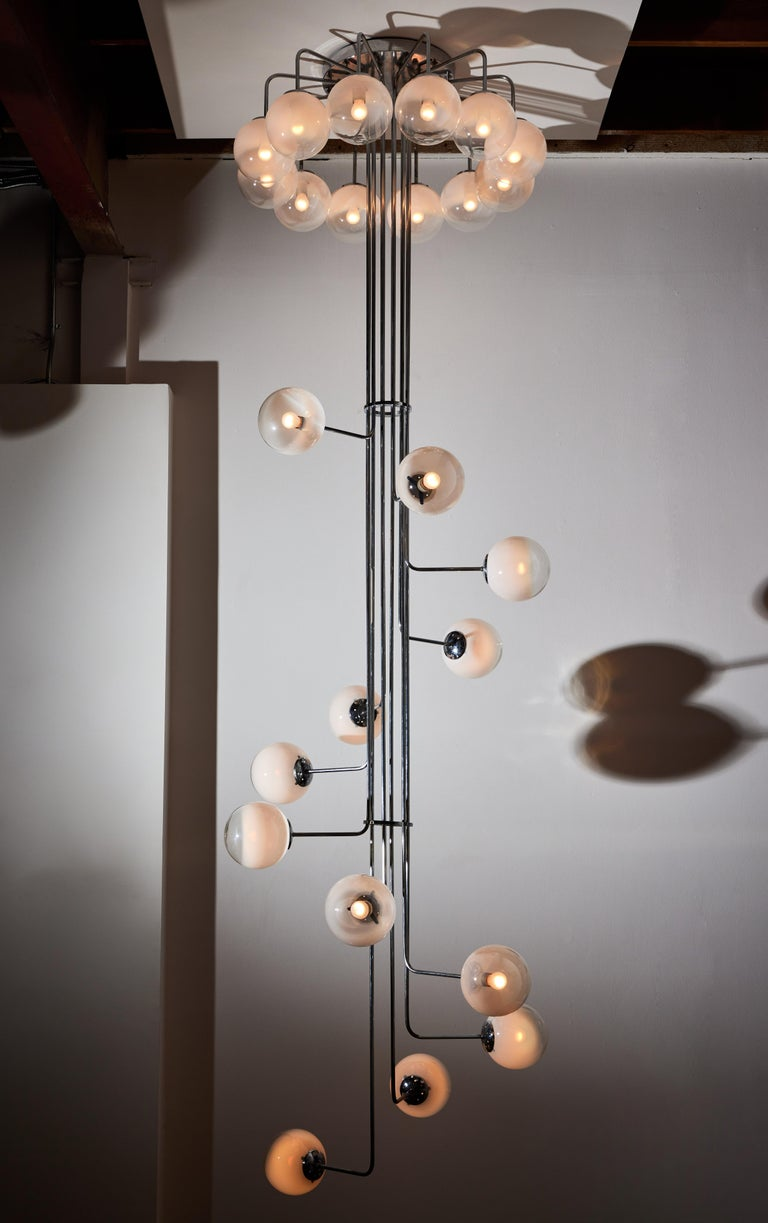 Rare monumental chandelier by Angelo Mangiarotti for Candle. Designed and manufactured in Italy, circa 1970s. Chrome, opaline glass diffusers. Rewired for U.S. standards. We recommend twenty four E25 25w maximum bulbs. Bulbs provided as a one time