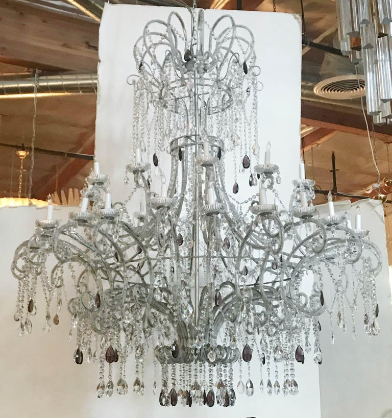 Vintage monumental Italian beaded Florentine chandelier with clear and amethyst faceted crystals mounted on wrought iron silver painted frame / Made in Italy, circa 1970s 36-light arranged in 2 tiers / E12 type / max 40W each Measures: Diameter 60