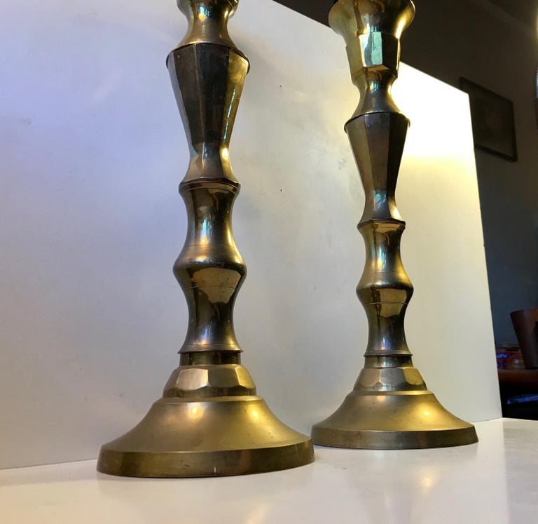 A pair of large church candlesticks in sculpted brass. These came out of a Church near Tjaeborg in the western part of Denmark. The design is very plain and almost has an Art Deco appearance to them. They have not been polished recently and the