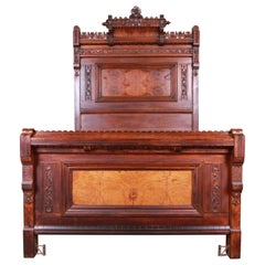 Monumental Eastlake Victorian Carved Walnut and Burl Wood Bed, circa 1870