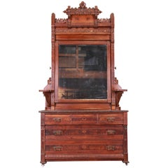 Monumental Eastlake Victorian Carved Walnut and Burl Wood Dresser with Mirror