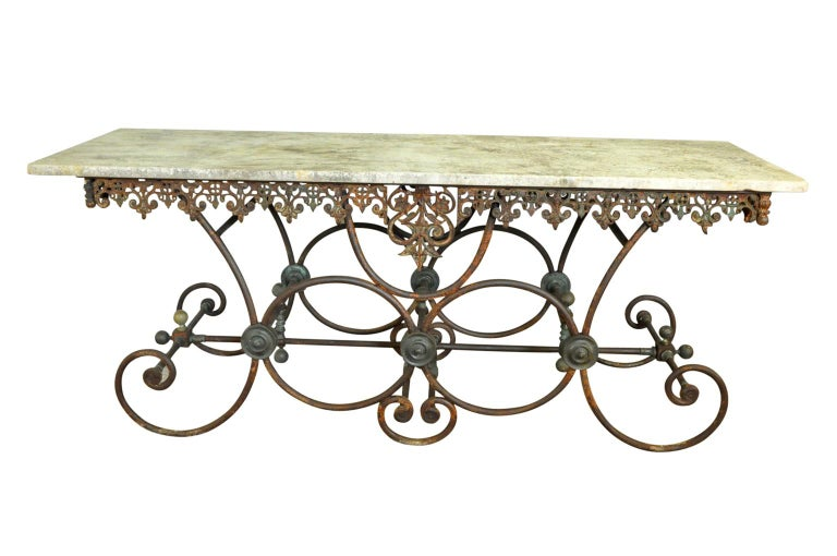 Outstanding and monumental butchers table from the Provence region of France. Soundly constructed with a beautifully cast iron base with its original marble top. Excellent quality and fabulous patina. Wonderful as a kitchen island, console, garden
