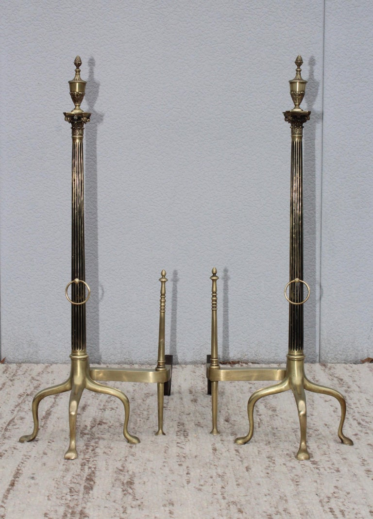 Stunning set of 1960s modern French brass andirons, lightly hand polished.