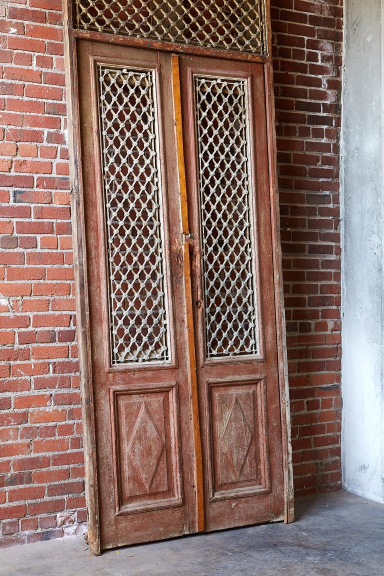 Monumental French Doors And Transom With Iron Grills For
