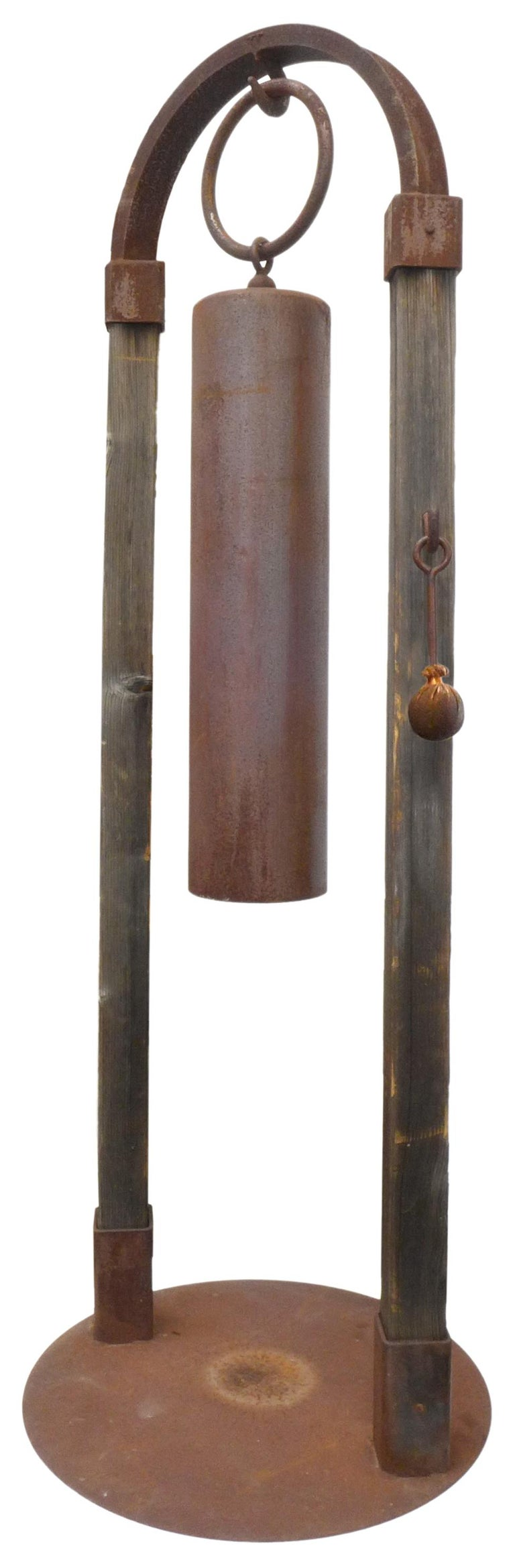 An incredible, monumental garden bell by Tom Torrens. A custom, Japanese-inspired edifice in iron and wood; an arch 7 feet in height suspending a large, cylindrical bell by oversized hook and ring. Custom, original iron and leather striking-mallet