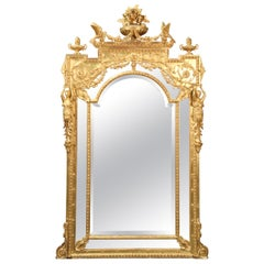 Monumental Giltwood French Regence Figural Mirror with Maidens and Birds