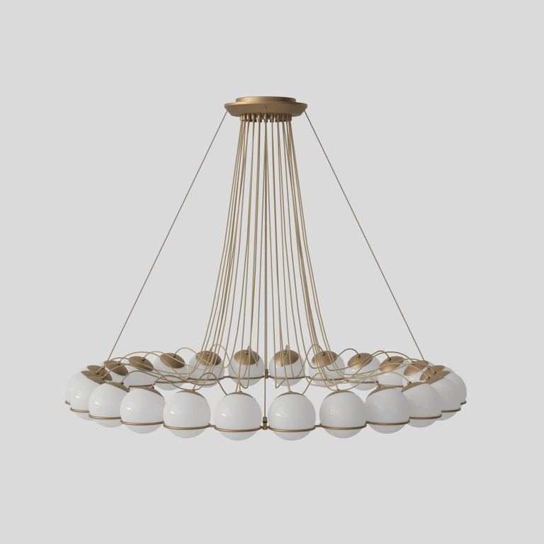 Gino Sarfatti Model 2109/24/14 chandelier in brass. The Le Sfere collection is the largest product family by Gino Sarfatti with models that have developed over time, from the first single sphere, Model 237, to the iconic twenty-four-sphere