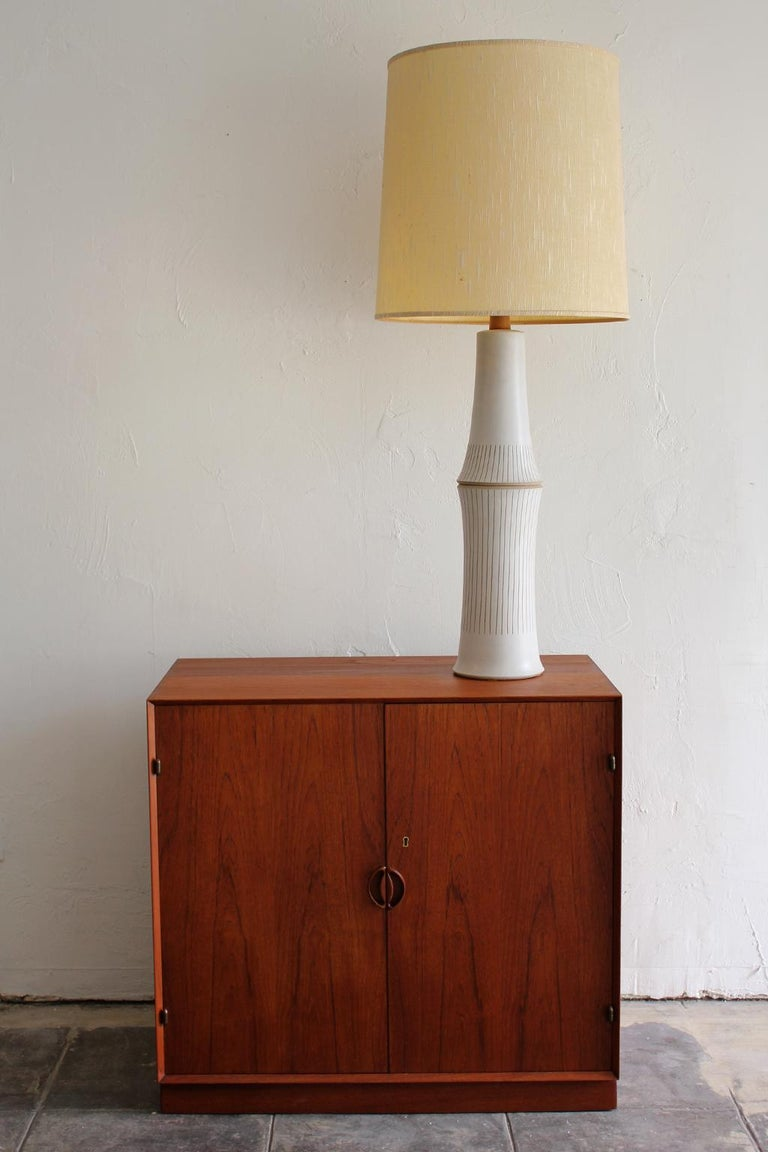 Monumental studio ceramic lamp by Gordon & Jane Martz. Comes with the original shade and is signed on the back lower edge. The tall ceramic lamp is a statement piece and is in excellent shape with no issues. You won't find a nicer one. Detailed