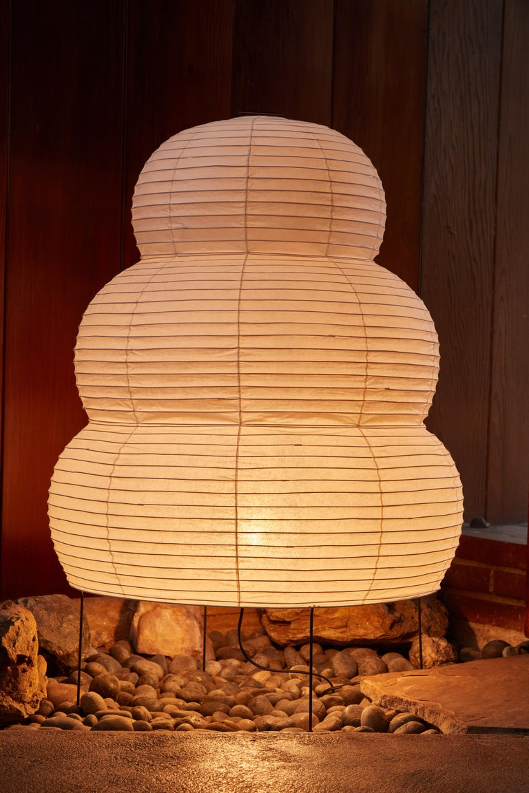 Monumental Isamu Noguchi Akari 25N floor lamp. The shade is made from handmade washi paper and bamboo ribs with Noguchi Akari manufacturer's stamp. Akari light sculptures by Isamu Noguchi are considered icons of 1950s modern design. Designed by