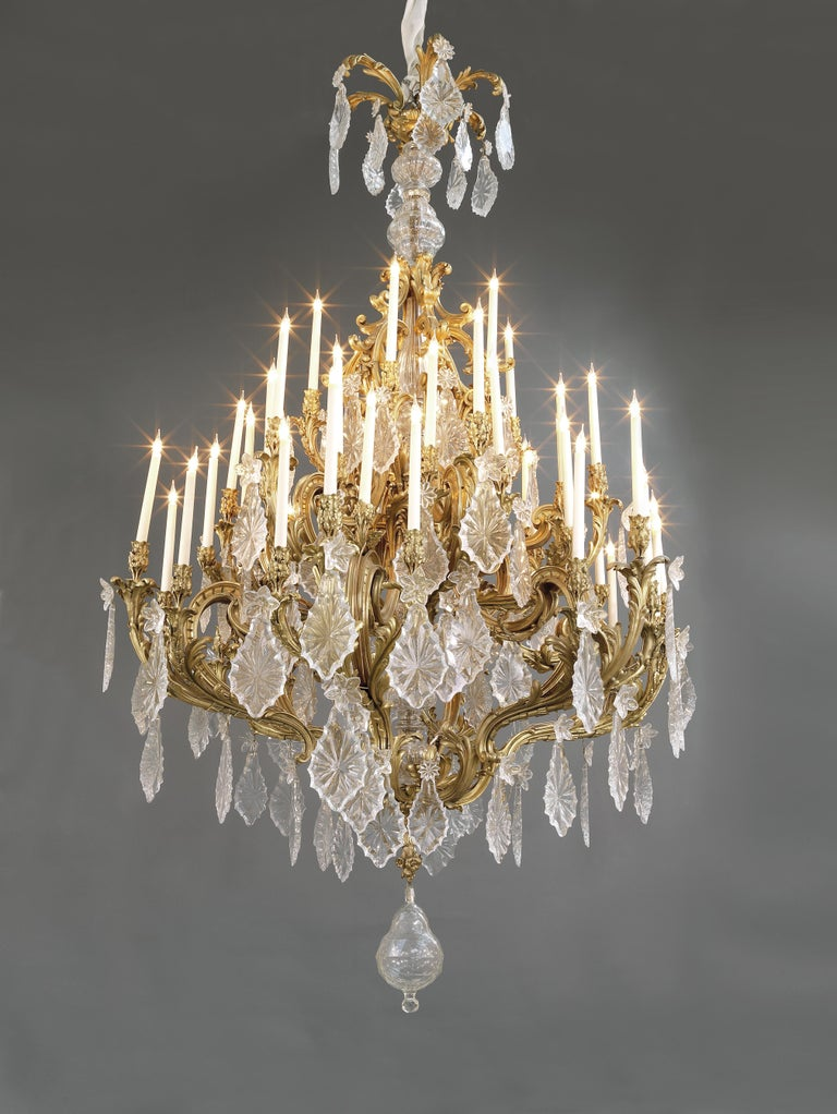 A monumental Louis XV Style gilt bronze and cut-glass forty-eight light chandelier. 