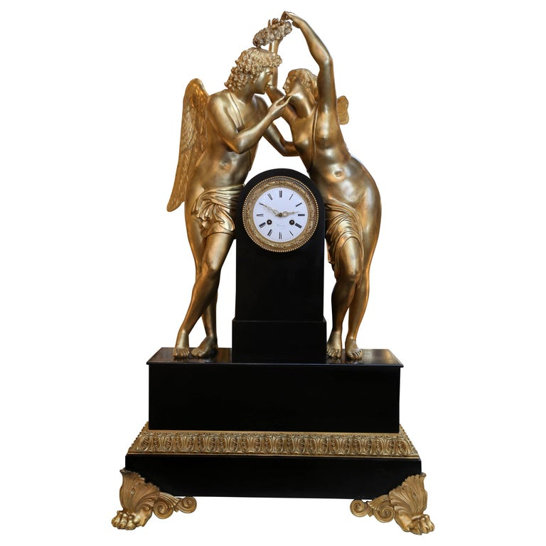 Monumental Marble and Bronze Dore' Clock Adorned with Psyche and Amor Figures For Sale