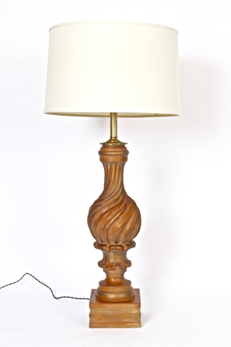 Substantial Italian hand carved Giltwood Table Lamp by Marbro Lamp Company, circa 1960.  Featuring handcrafted swirled wood body lightly striped in gold. On block base. Small footprint. Shade shown for display only (11H x 17D top x 18D bottom).