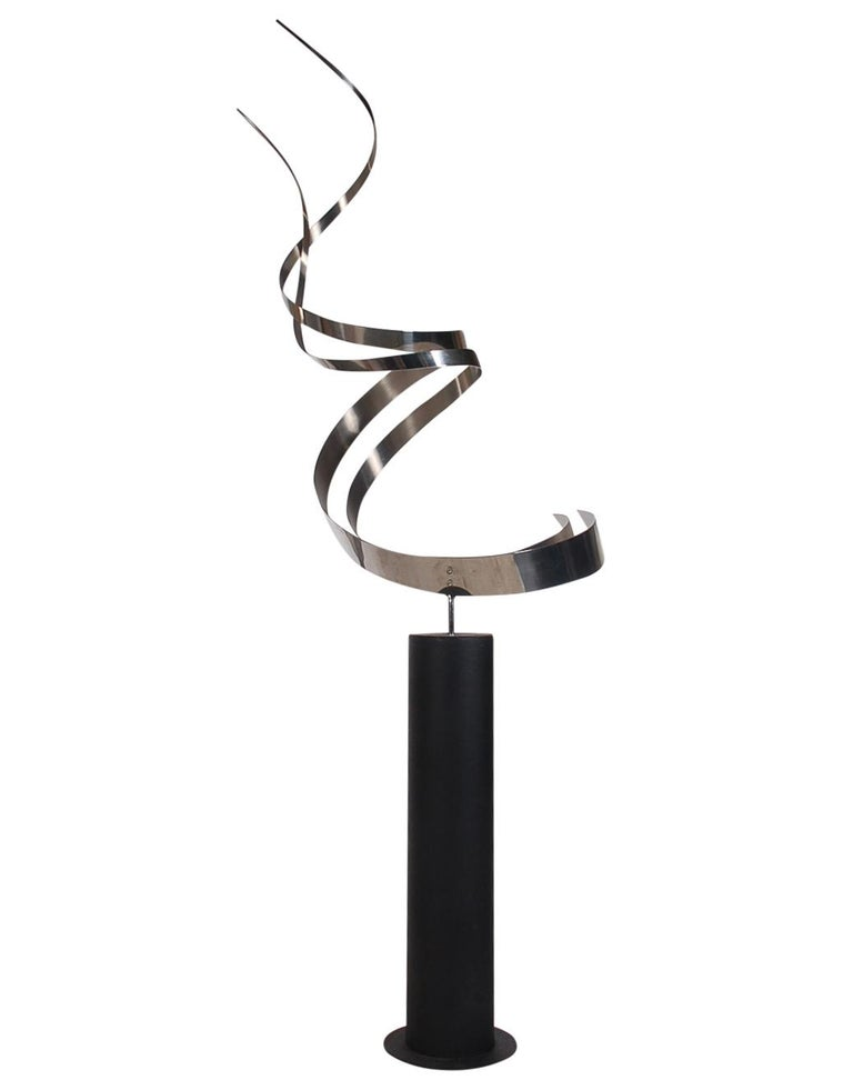 A large and impressive floor sculpture designed by Curtis Jere and produced by Artisans House. This piece features a heavy black iron base with an abstract stainless steel form sculpture.