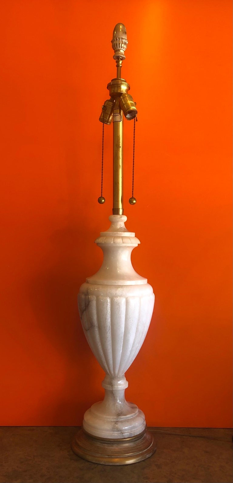 Incredible monumental midcentury hand carved marble table lamp by Marbro Lamp Company, circa 1960s. This lamp is massive and very impressive standing 40