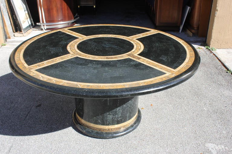 Monumental Mid-Century Modern Maitland Smith tessellated stone Round dining table or center table Made in the 1970s.The dining or center table is beautiful with three color of tessellated stone. Brown color and dark green color and light brown