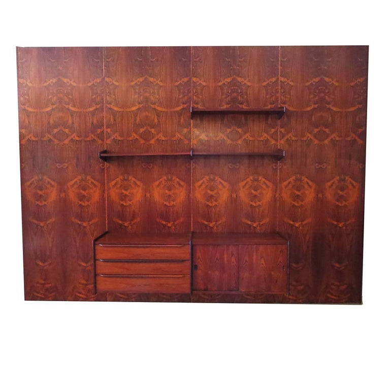 There are a few of these European wall units that have come on the market, but none that can equal the beautiful grain pattern of this rosewood. The unit consists of four bookmatched panels of highly figured rosewood, plus a thinner panel (not