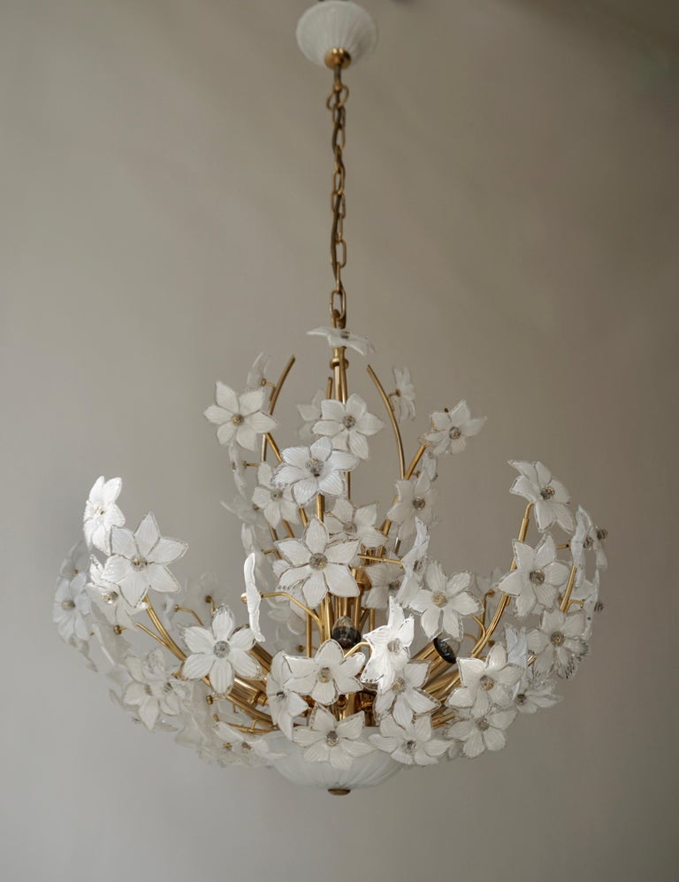 Large 1970s vintage midcentury Italian Murano flower bouquet Chandelier attributed to Venini. Art glass with 88 hand blown white and clear glass flowers and gold-plated brass.  The glass flowers are attached with glass screws and the ceiling plate