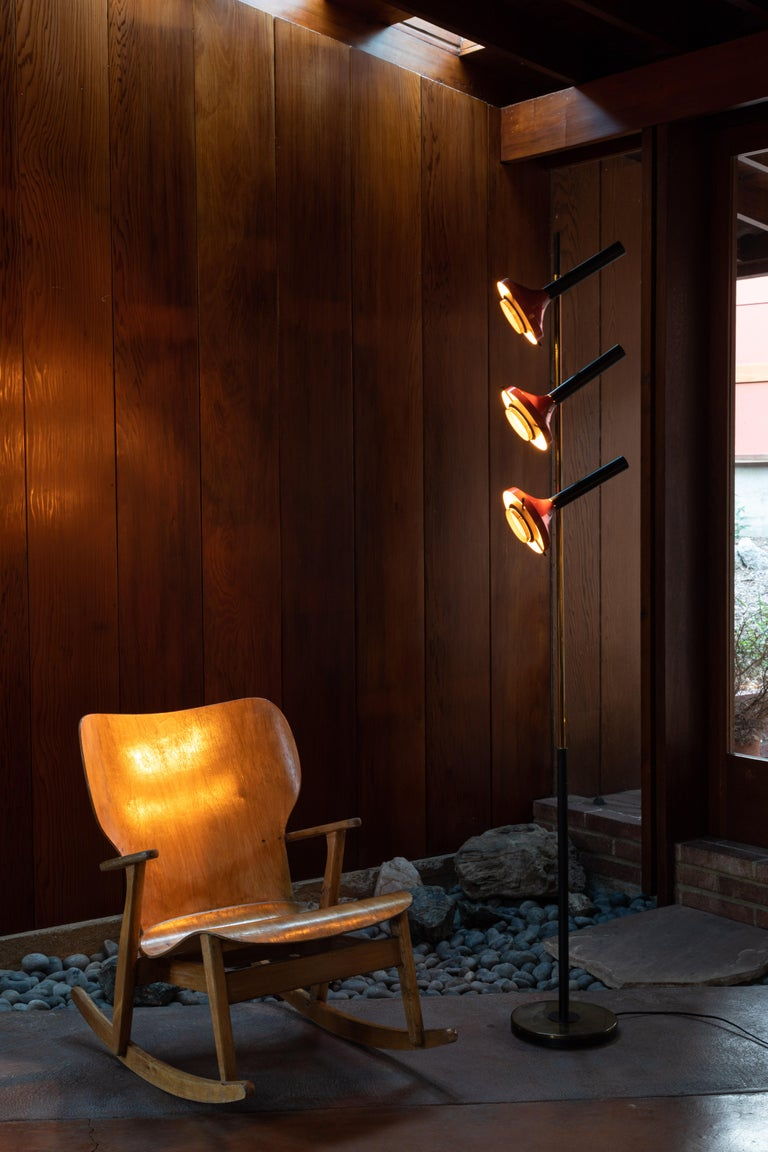 Monumental Oscar Torlasco 3-cone floor lamp for Lumi circa 1958. Iron base, tubular brass, sheet brass, part black, sheet aluminum, painted red, optical glass. Retains original manufacturers label. Each of the three shades have their own on/off