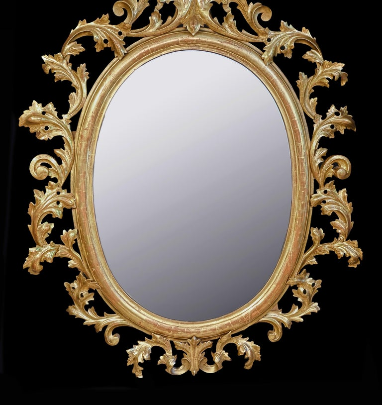 European Monumental Pair of 19th Century Oval Florentine Carved Giltwood Mirrors For Sale