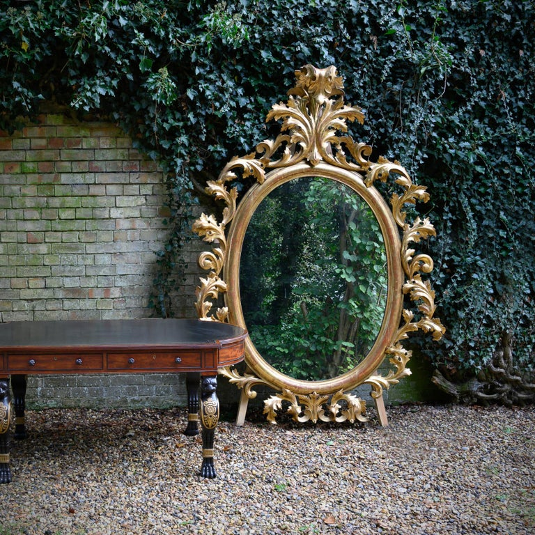 Monumental Pair of 19th Century Oval Florentine Carved Giltwood Mirrors For Sale 3