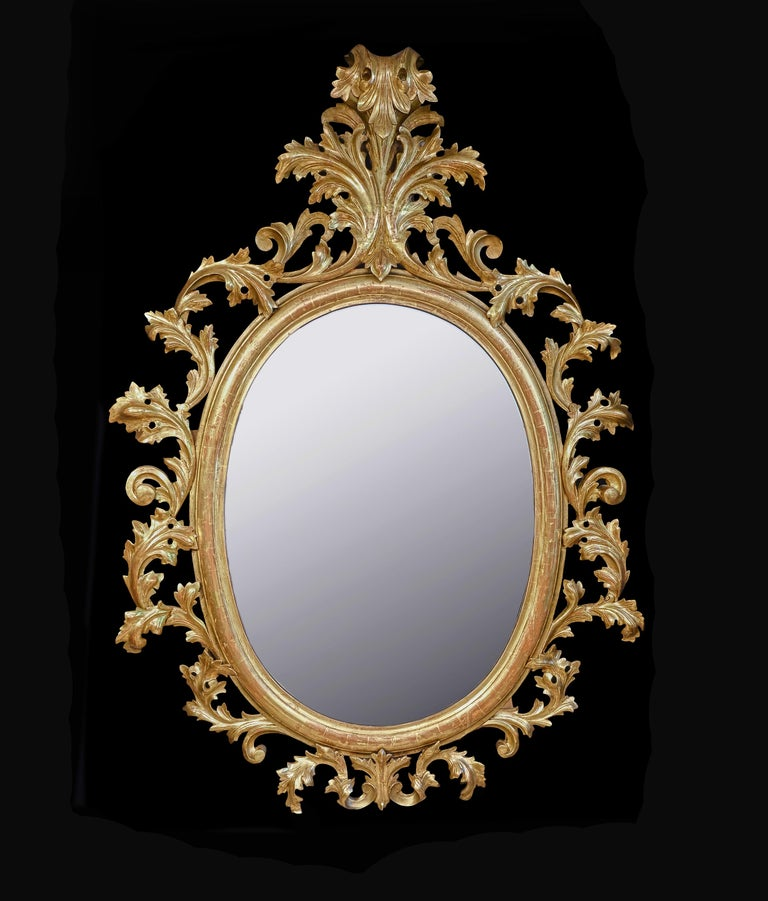 Monumental Pair of 19th Century Oval Florentine Carved Giltwood Mirrors For Sale 5