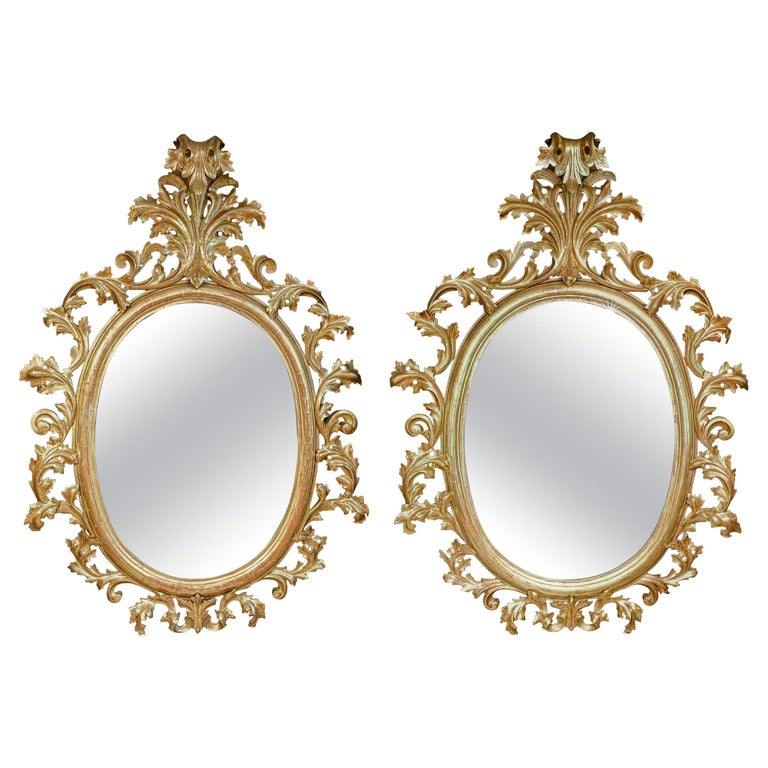 Monumental Pair of 19th Century Oval Florentine Carved Giltwood Mirrors For Sale