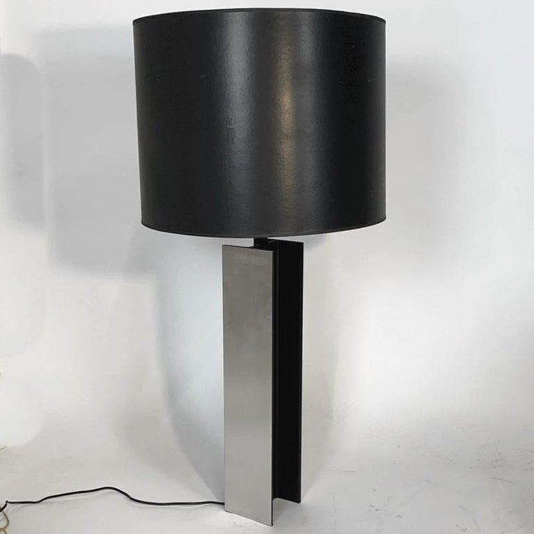 Pair of Laurel I Beam Lamps with original shades. Design is attributed to Jeff Jones. Polished aluminum i beam base with matte black finished detail. Lamps are 5 inch square and 38 inch high. The shades are 20 wide by 15 high. Shades are original-