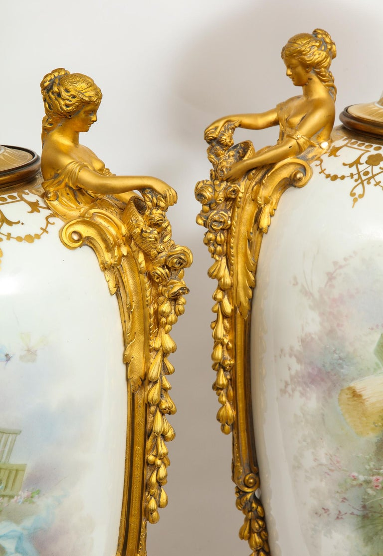 Monumental Pair of French Ormolu-Mounted White Sèvres Porcelain Vases and Covers For Sale 4