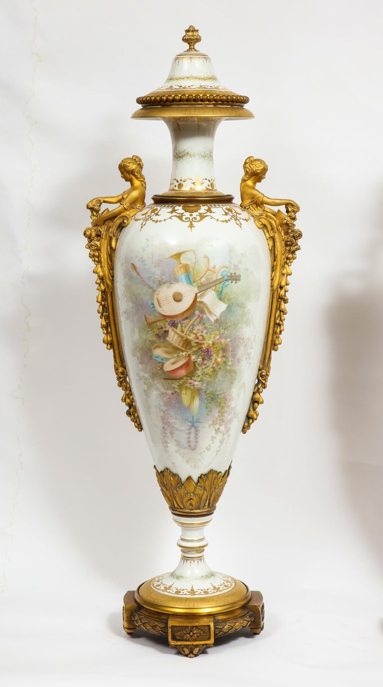 Monumental Pair of French Ormolu-Mounted White Sèvres Porcelain Vases and Covers For Sale 6