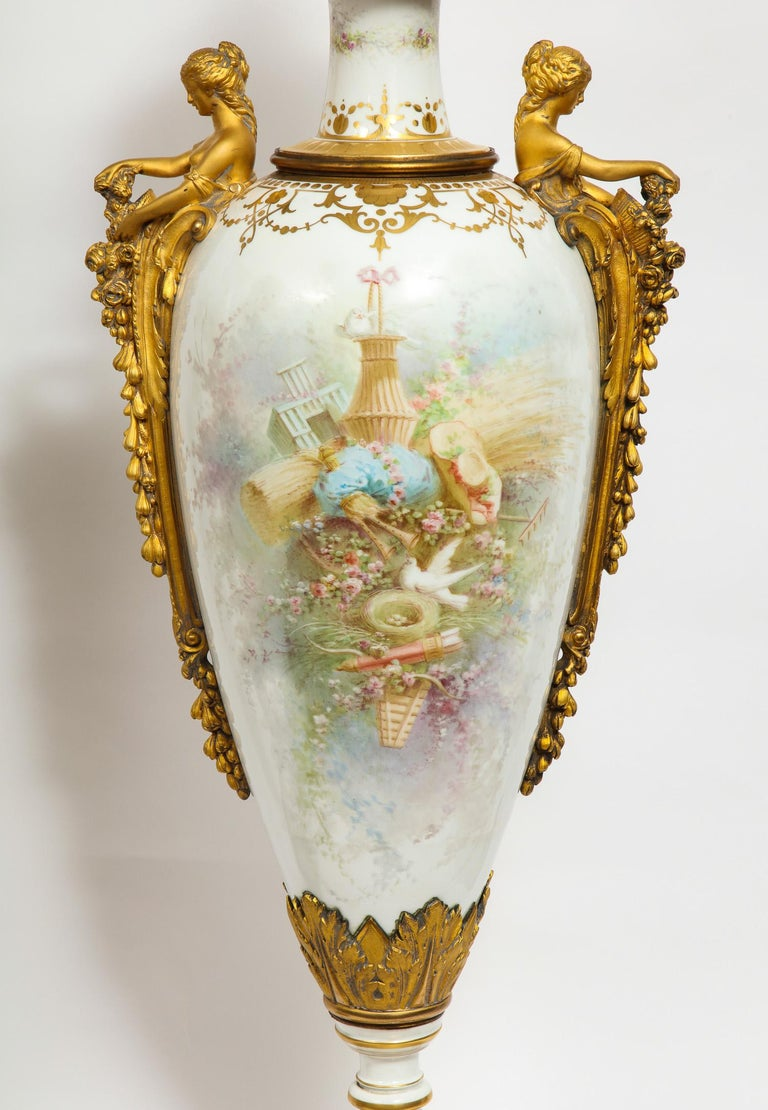 Monumental Pair of French Ormolu-Mounted White Sèvres Porcelain Vases and Covers For Sale 8