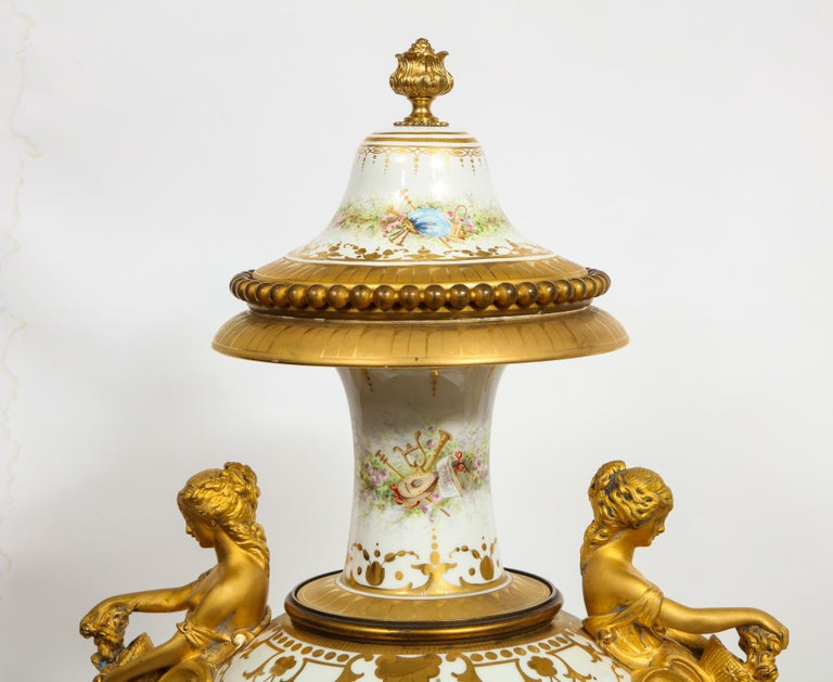 Monumental Pair of French Ormolu-Mounted White Sèvres Porcelain Vases and Covers For Sale 12