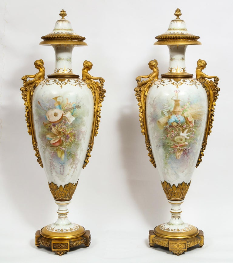 Monumental pair of French ormolu-mounted White Sèvres Porcelain vases and covers,  by Collot,   France, 19th century.  Measures: 42