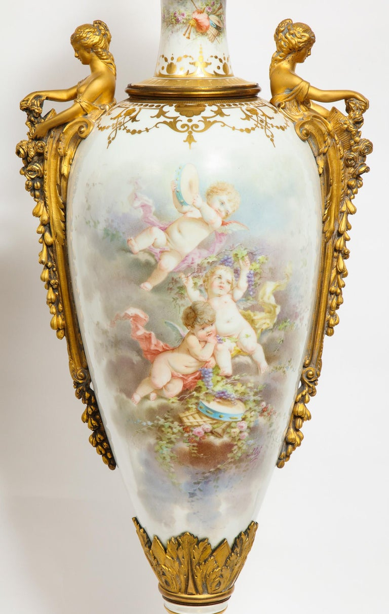Monumental Pair of French Ormolu-Mounted White Sèvres Porcelain Vases and Covers In Good Condition For Sale In New York, NY