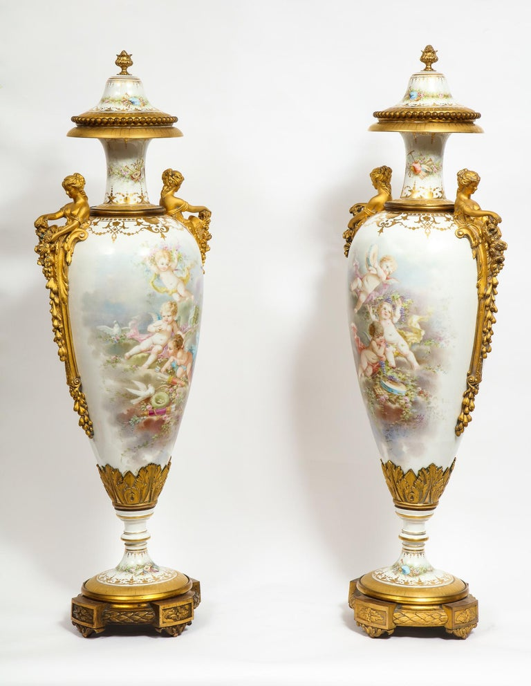 Monumental Pair of French Ormolu-Mounted White Sèvres Porcelain Vases and Covers For Sale 1