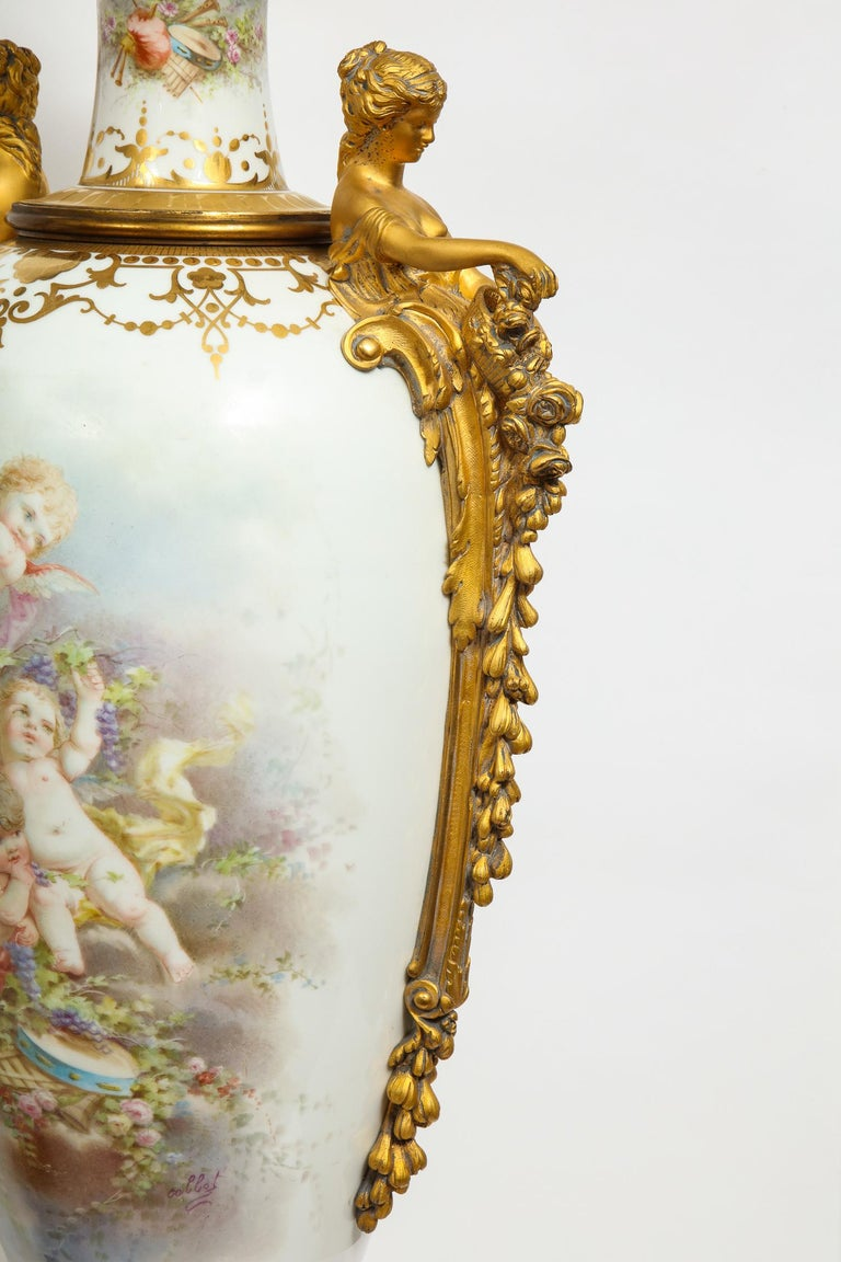Monumental Pair of French Ormolu-Mounted White Sèvres Porcelain Vases and Covers For Sale 2
