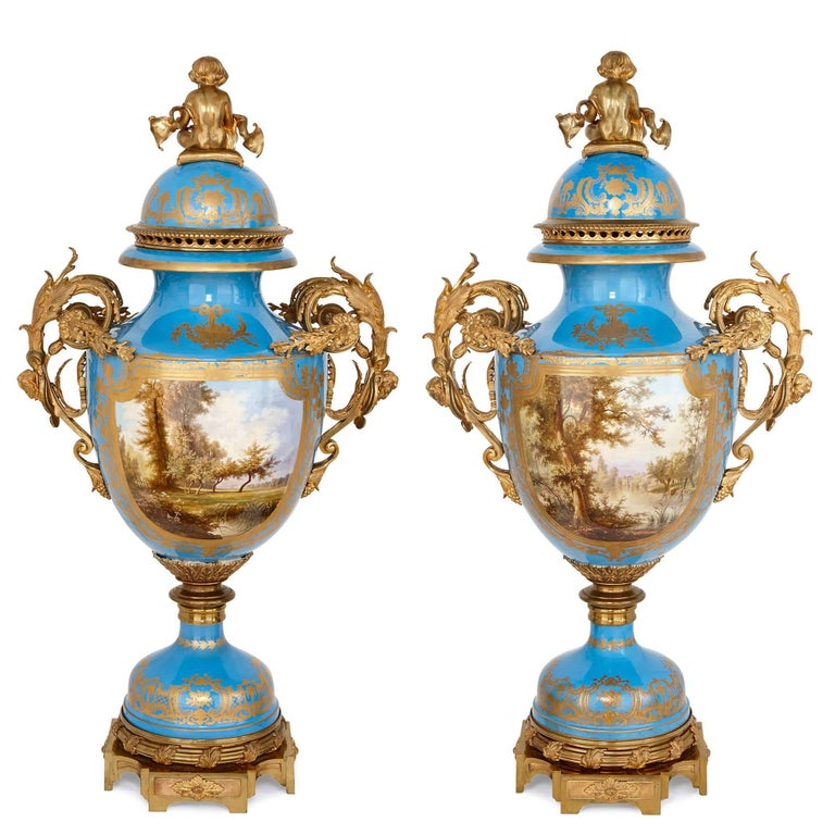 These extremely large vases are lavish, opulent works of porcelain and bronze, with every element elaborately and painstakingly crafted. Built in the Rococo style, the vases are designed for a grand entrance-way or room, and are truly exceptional