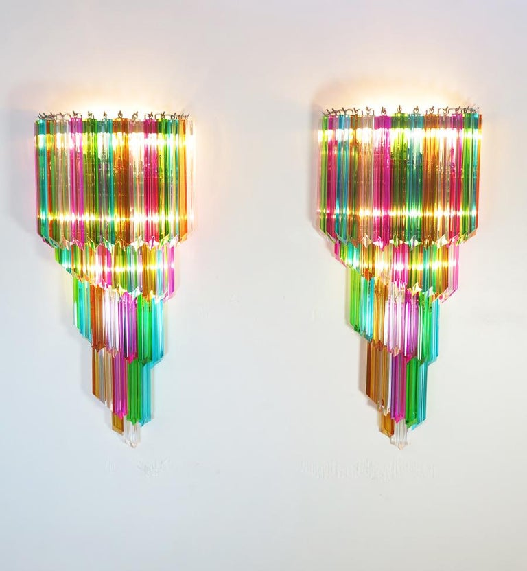 Huge and fantastica pair of vintage Murano wall sconce made by 41 Murano crystal prism (quadriedri) for each applique in a chrome metal frame. The shape of this sconce is spiral. The glasses are transparent, blue, smoky, purple, green, yellow and