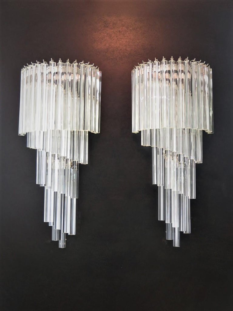 Huge and fantastica pair of vintage Murano wall sconce made by 41 Murano crystal prism (triedri) for each applique in a chrome metal frame. The shape of this sconce is spiral. The glasses are transparent.